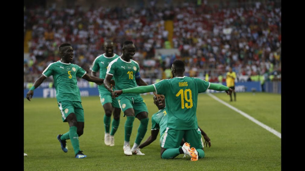 Senegal's Mbaye Niang, right, celebrates with his teammates scoring his side's second goalduring the group H match between Poland and Senegal at the 2018 soccer World Cup in the Spartak Stadium in Moscow, Russia, Tuesday, June 19, 2018