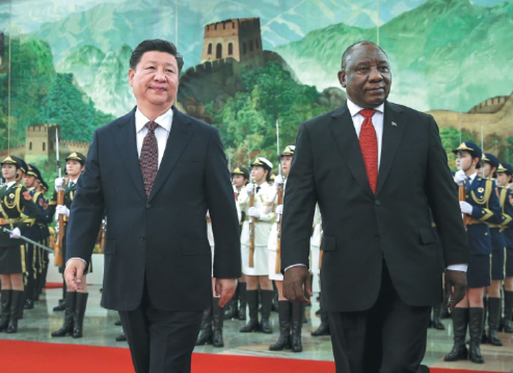 President Xi Jinping accompanies South African President Cyril Ramaphosa in the Great Hall of the People in Beijing on Sunday.