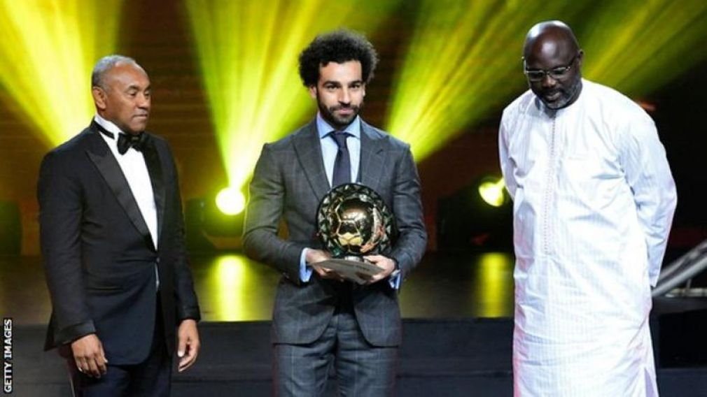 Mohamed Salah was presented with his award by Caf president Ahmad Ahmad (left) and Liberia president George Weah (right)