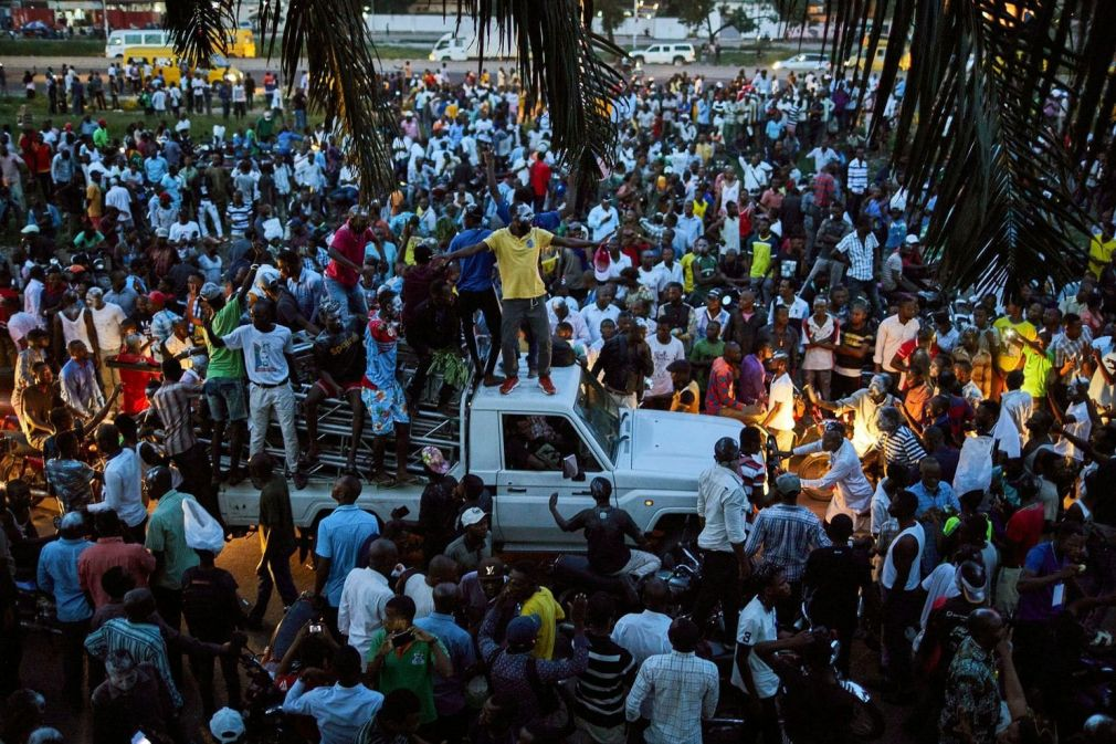 Supporters of Felix Tshisekedi, the leader of the Union for Democracy and Social Progress party, rally outside his headquarters in Kinshasa as they wait for the electoral commission to announce the results of the Dec. 30 election.