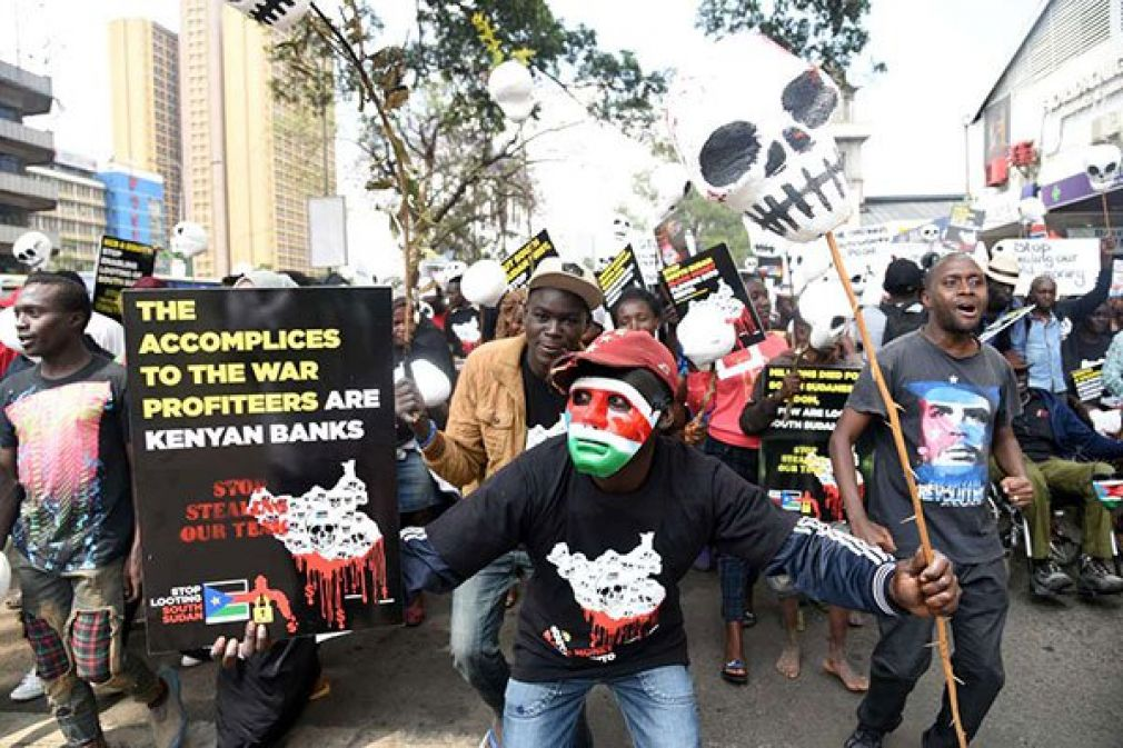 Demonstrators in Nairobi protest against alleged looting of funds by prominent leaders and politicians in South Sudan who bank it in Kenyan and Ugandan banks.