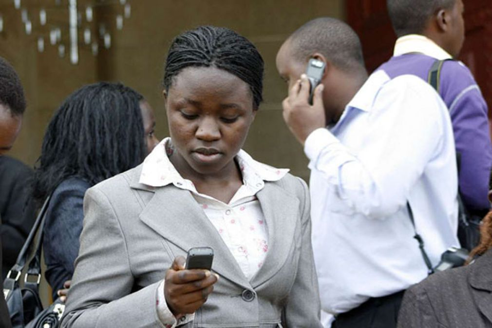 A woman using a mobile phone. Africa accounts for just nine per cent of total global mobile subscriptions.