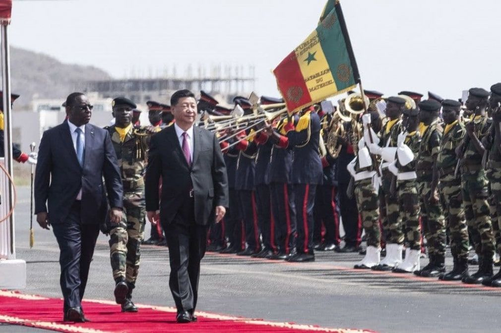 Senegal President Macky Sall, left, and Chinese President Xi Jinping inspect the honor guard during a state visit in Dakar, Senegal, on July 21, 2018.