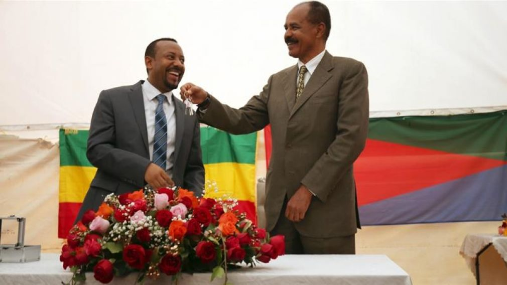 Eritrea's President, Isaias Afwerki receives a key from Ethiopia's PM Abiy Ahmed during a ceremony marking the reopening of the Eritrean Embassy in Addis Ababa on July 16, 2018.