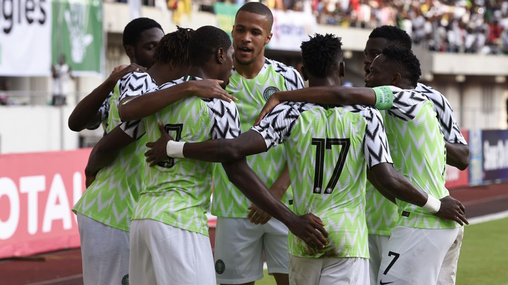 Nigerian players celebrate a goal during the African Cup of Nations qualification match between Nigeria and Libya in Uyo, Akwa Ibom State in southern Nigeria, on October 13, 2018. – Nigeria beat Libya 4-0 with Odion Ighalo grabbing a hat-trick for the Super Eagles to get their 2019 Africa Cup of Nations qualifying campaign firmly back on track in Uyo, southern Nigeria.
